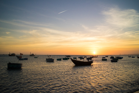 oceanscape: boats in sunset