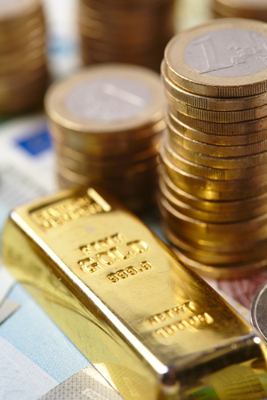 goldbar: gold bar and coins Stock Photo
