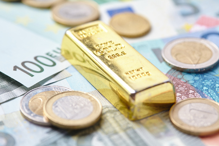 goldbar: gold bar on money Stock Photo