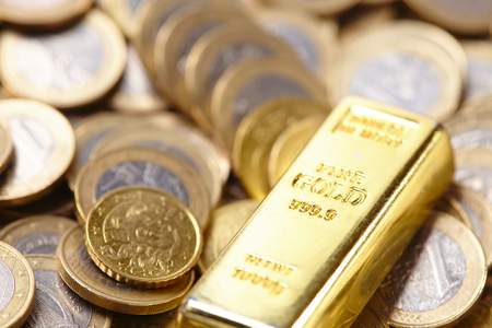 goldbar: gold bar with coins Stock Photo