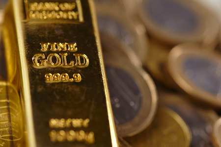 goldbar: gold bar with coins Stock Photo