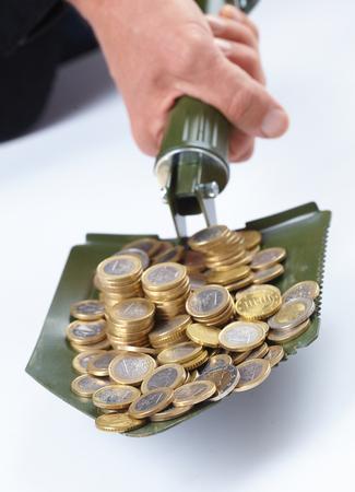remuneration: shovel with money Stock Photo