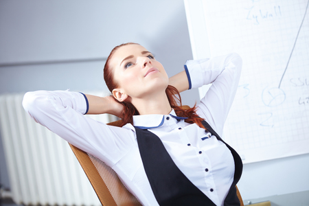 Young businesswoman sitting at workplace photo