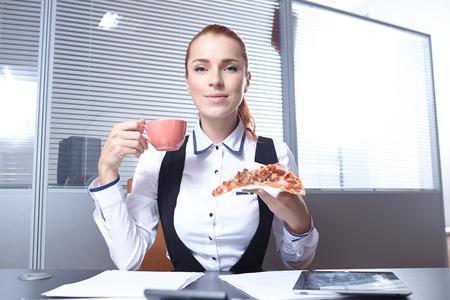 businesswomen with pizza photo
