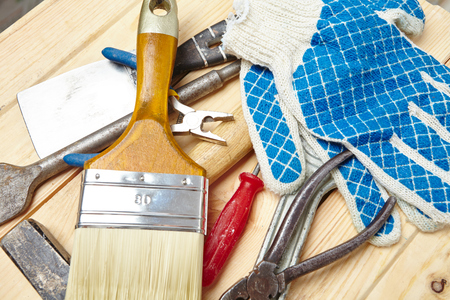 work from home: set of tools on the wood background