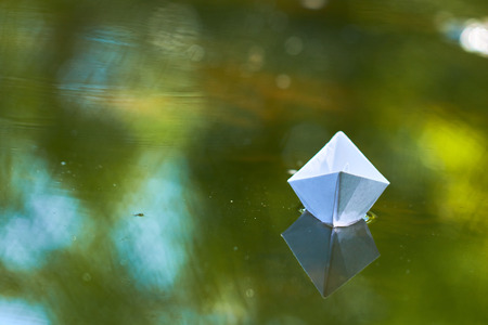 paper boat on the water Stock Photo