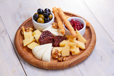 cheese plate with olives Stock Photo