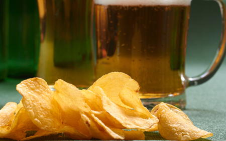 potato chips and beer Фото со стока