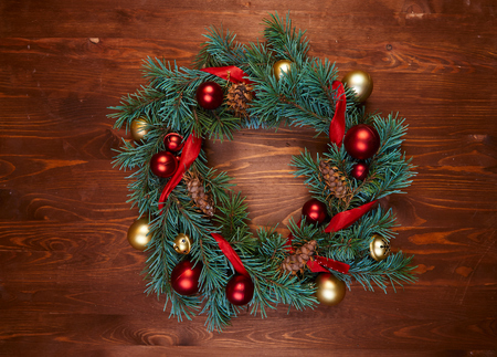 christmas wreath with red and golden balls Standard-Bild