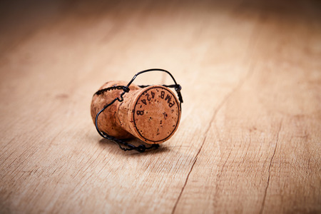 Champagne cork with text on cap