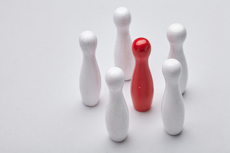 Business concept, white and red skittle