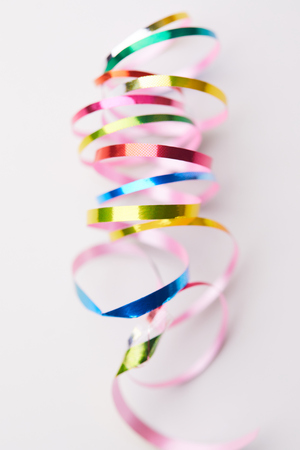 colorful holiday ribbons on the white background Stock Photo