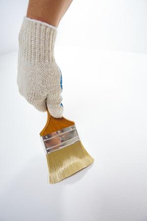 Man hand holding new paint brush