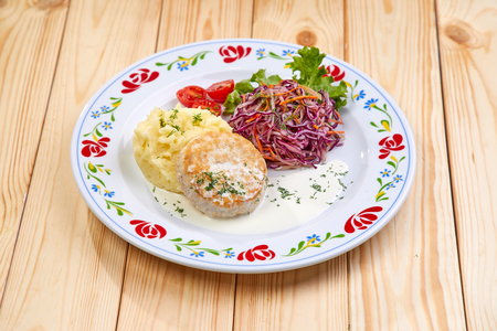 cutlet with mashed potato and salad