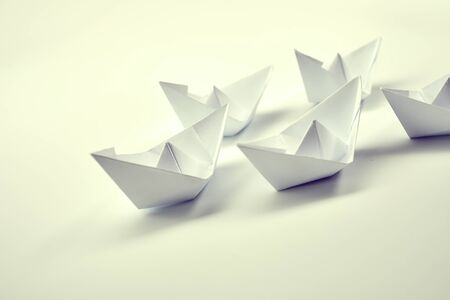 Paper boats on white