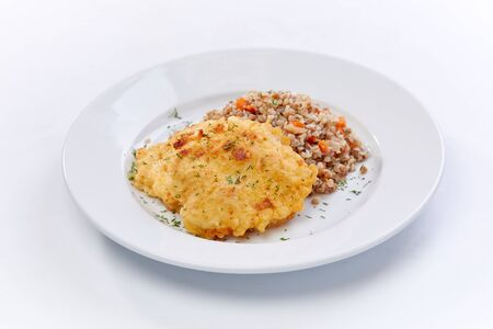 fried chicken breast with buckwheat on the white background