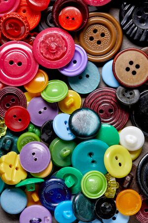 Background and texture of multicolored antique buttons