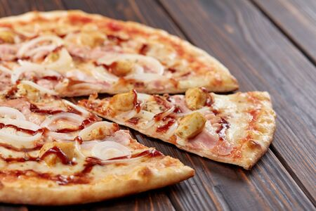 tasty pizza on the wooden background