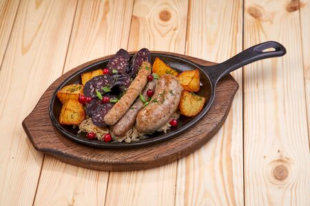 sausage with baked potatoes and cranberries