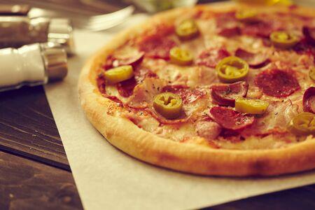 tasty pizza on the wooden background Foto de archivo