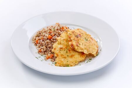 fried chicken with buckwheat on the white background