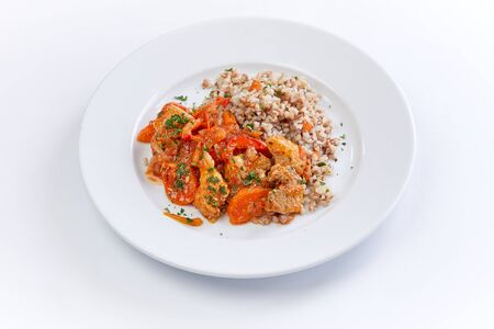 chicken with buckwheat on the white background