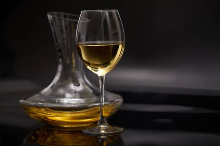 A glass full of wine and wine decanters