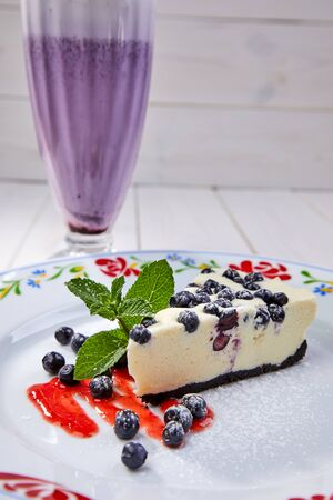 cheesecake with fresh blueberries and mint