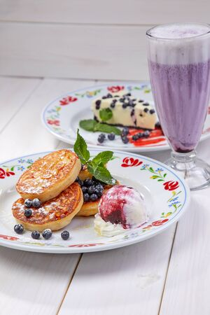 pancakes with ice cream and blueberries