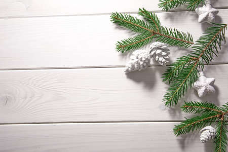 Christmas card - Christmas tree branches on the wooden background Archivio Fotografico