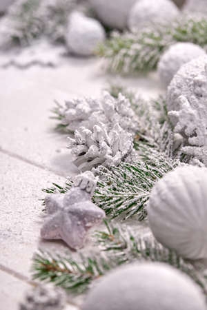 Christmas card - white ball and cones on the wooden background