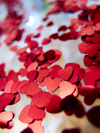 hearts confetti on the golden background