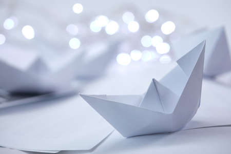paper boats with small lights Banco de Imagens