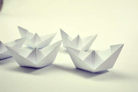 paper boats on the white