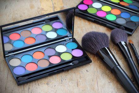 Makeup brushes make-up eye shadows vintage wooden background