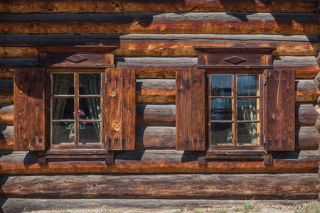 Windows in a traditional wooden house photo