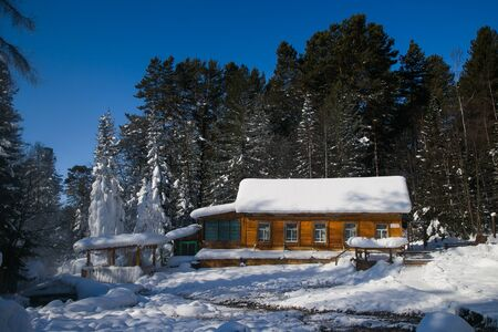 log cabin in snow: Wooden house near the hot springs in Siberia