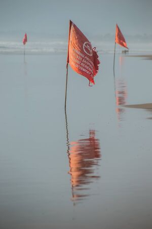 A red flag prohibits swimming in sea