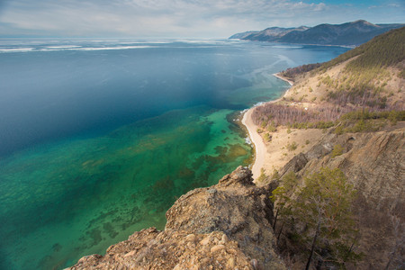 Top view on the coast of Lake Baikal. Rocks and beach. 版權商用圖片