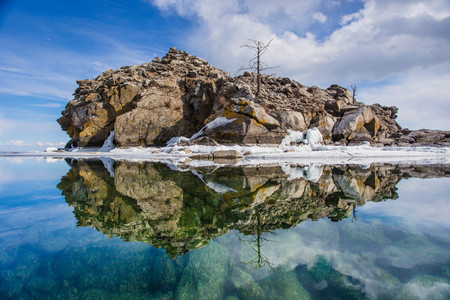 Mirroring a rocky island in the water in Lake Baikal in Siberia