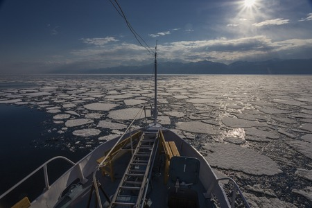 Nose of ship and view of icebergs in Baikal lake Banco de Imagens