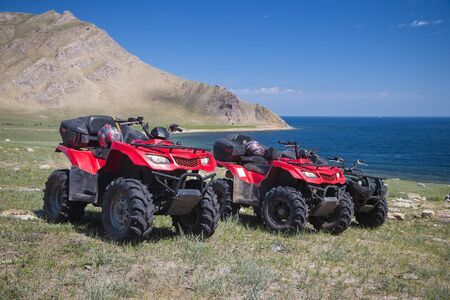 ATVs on the background of the shore Baikal lake Banco de Imagens