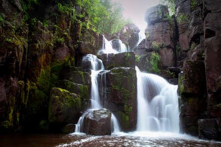 Beautiful waterfall on a mountain river in Siberia