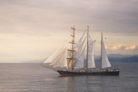 Beautiful sailboat at sunset in Black sea 版權商用圖片