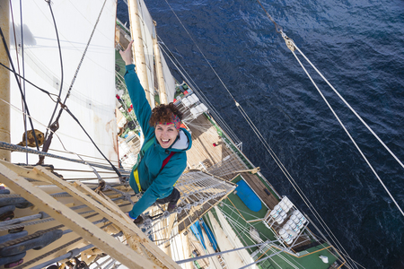 Girl student rises to the mast of an old frigate