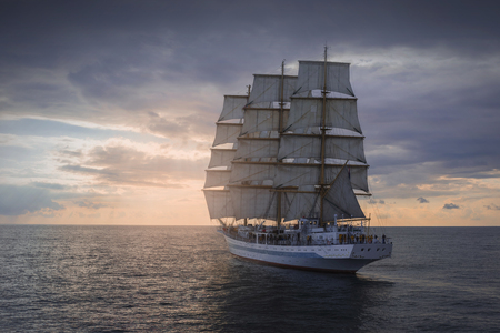 Ancient sailing ship in the sea at sunset Standard-Bild