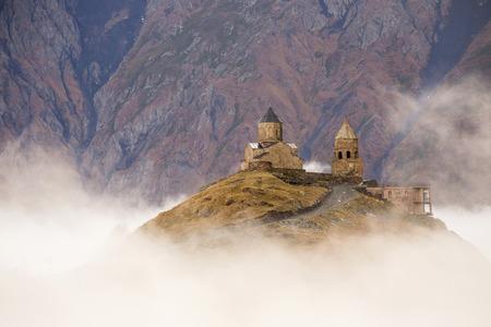Gergeti Church in fog. Kazbegi mount