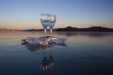 Glasses on the transparent ice of Lake Baikal in Siberia Banco de Imagens