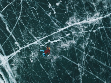 Girl on the ice of Lake Baikal