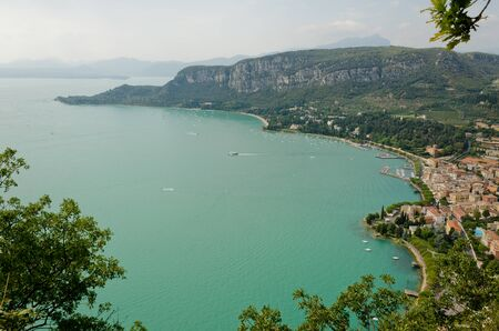 sirens: Lake Garda, Italy - Panoramic view of the lake from the top of the hill The coast from Garda to Punta San Vigilio, near the bay of the Gulf of sirens Garda seen from the Rocca di Garda, a rocky outcrop overlooking Lake Garda Stock Photo